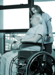 caregiver assisting an elderly