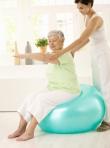 caregiver assisting an elderly