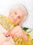 elderly lady taking medicine