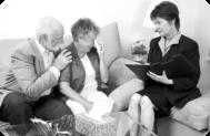 caregiver assisting senior couple