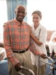 caregiver assisting her senior patient