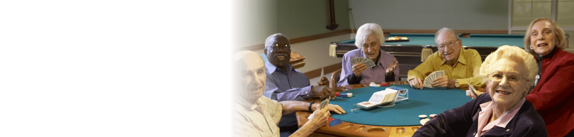 Group of old people are playing cards