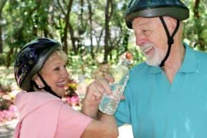 senior couple smiling drinking water